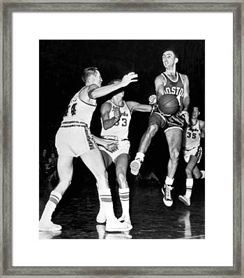 Bob Cousy Passes Basketball Framed Print by Underwood Archives