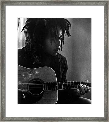 Bob Marley Leaning Over Guitar Framed Print by Retro Images Archive