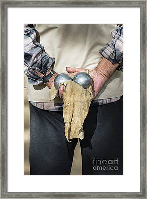 Bocce Player Framed Print by John Greim