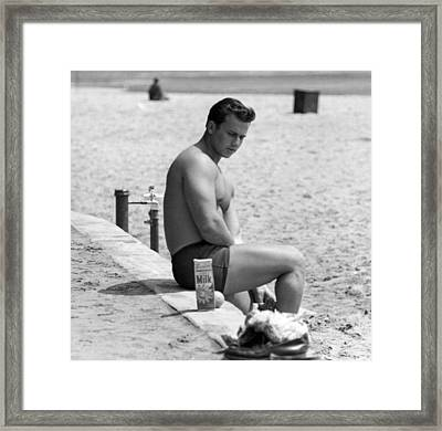 Body Builder At The Beach. Framed Print by Underwood Archives