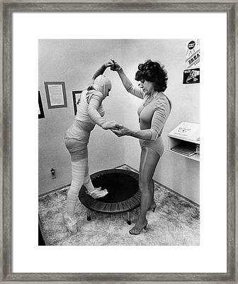 Body Wrap Exercise Framed Print by Underwood Archives
