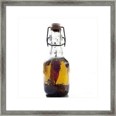 Bottle Of Oil Framed Print by Bernard Jaubert