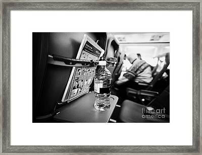 Bottle Of Water On Tray Table Interior Of Jet2 Aircraft Passenger Cabin In Flight Europe Framed Print by Joe Fox
