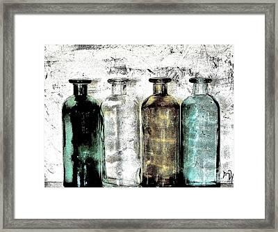 Bottles Against The Wall Framed Print by Marsha Heiken