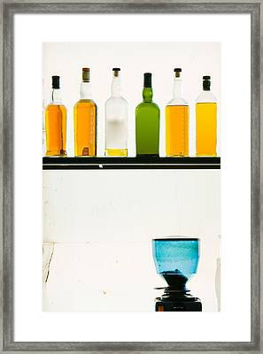 Bottles Displayed At The Bookworm Cafe Framed Print by Panoramic Images