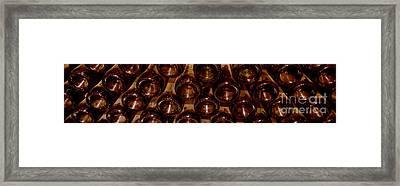 Bottles In The Cellar Framed Print by Jon Neidert