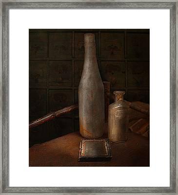 Bottles Framed Print by Jeff Burgess