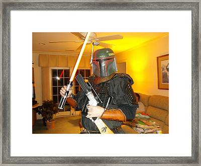 Bounty Hunter Through All Times Framed Print by James Potts
