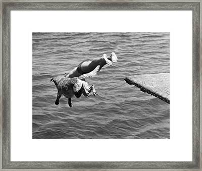 Boy And His Dog Dive Together Framed Print by Underwood Archives