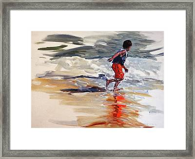 Boy Chases Waves On Beach Framed Print by Christine Montague