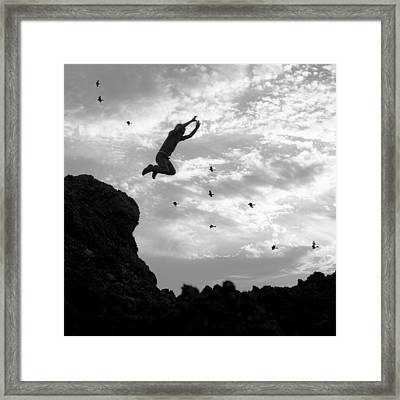 Boy Jumping With Birds Framed Print by Donald  Erickson