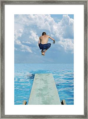 Boy Jumps Into Water Framed Print by Darren Greenwood