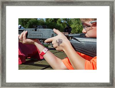 Boy Shooting A Bb Gun Framed Print by Jim West
