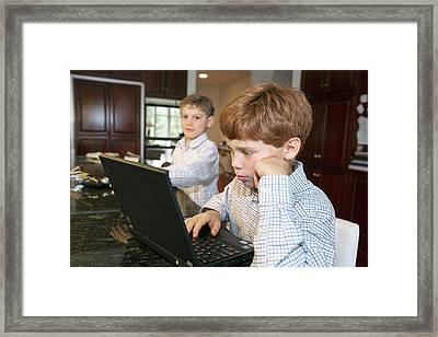 Boy Using A Laptop Framed Print by Jim West