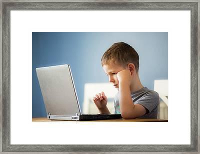 Boy Using Laptop Framed Print by Samuel Ashfield