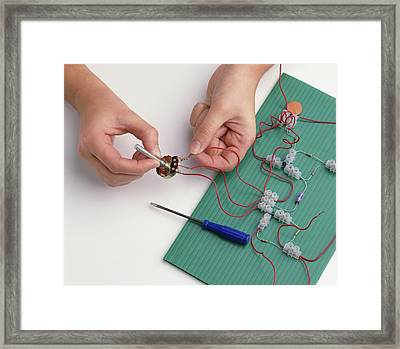 Boy's Hands Attaching Wires Framed Print by Dorling Kindersley/uig
