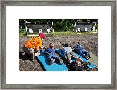Boys Shooting Bb Guns Framed Print by Jim West