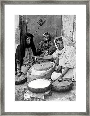 Bread Making Framed Print by Munir Alawi
