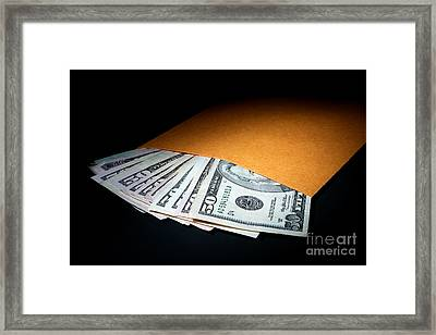 Bribery Framed Print by Olivier Le Queinec