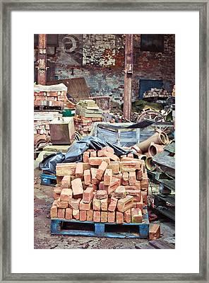 Bricks In Scrap Yard Framed Print by Tom Gowanlock