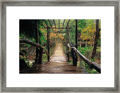 Bridge Over Waterfall Framed Print by Nawarat Namphon