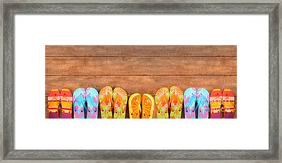 Brightly Colored Flip-flops On Wood  Framed Print by Sandra Cunningham