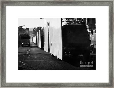 British Army Screen Bedford Trucks And Psni Water Canon On Crumlin Road At Ardoyne Shops Belfast 12t Framed Print by Joe Fox