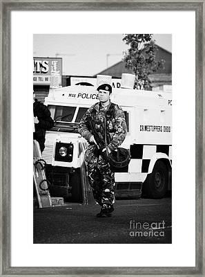 British Army Soldier At Psni Landrover On Crumlin Road At Ardoyne Shops Belfast 12th July Framed Print by Joe Fox