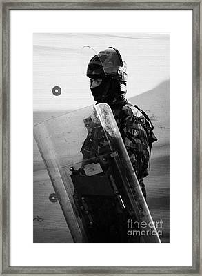 British Army Soldier With Helmet And Shield Riot Gear On Crumlin Road At Ardoyne Shops Belfast 12th  Framed Print by Joe Fox