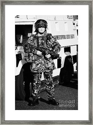 British Army Soldier With Mp5 On Crumlin Road At Ardoyne Shops Belfast 12th July Framed Print by Joe Fox