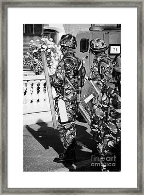 British Army Soldiers In Riot Gear With Fire Extinguisher On Crumlin Road At Ardoyne Shops Belfast 1 Framed Print by Joe Fox