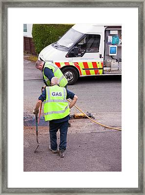 British Gas Workers Replacing Old Pipes Framed Print by Ashley Cooper