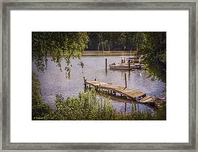 Broken Pier And Sunken Boat Framed Print by Brian Wallace