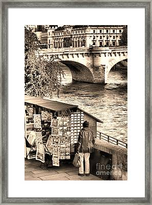 Browsing The Outdoor Bookseller  Framed Print by Olivier Le Queinec