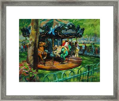Bryant Park - The Carousel Framed Print by Peter Salwen