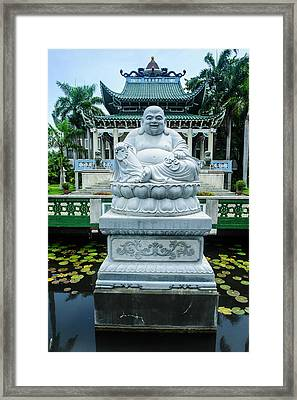 Buddhist Statue Before The Taoist Framed Print by Michael Runkel