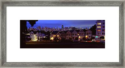 Buildings Lit Up Dusk, Alamo Square Framed Print by Panoramic Images