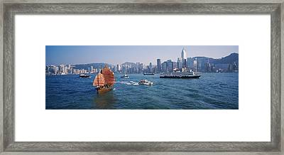 Buildings On The Waterfront, Kowloon Framed Print by Panoramic Images