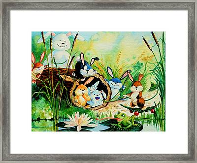 Bunnies Log And Frog Framed Print by Hanne Lore Koehler