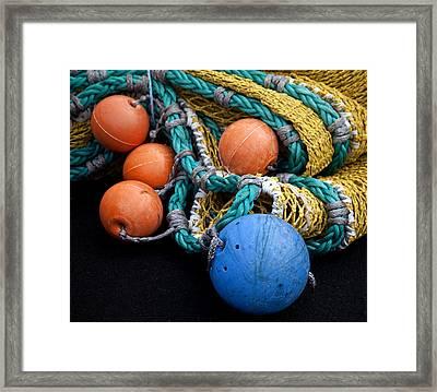 Buoys And Nets Framed Print by Carol Leigh