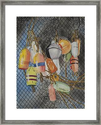 Buoys And Netting Framed Print by John Edebohls