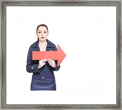 Business Woman Holding Direction Arrow Sign Framed Print by Jorgo Photography - Wall Art Gallery
