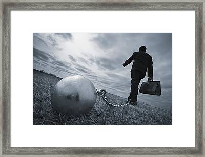 Businessman With Ball And Chain Framed Print by Don Hammond
