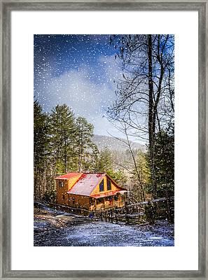 Cabin In The Snow Framed Print by Debra and Dave Vanderlaan