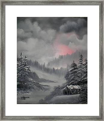 Cabin In The Winter Forset Framed Print by James Waligora