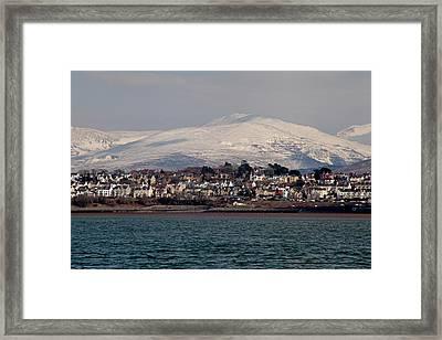 Caernarfon From The Menai Strait Framed Print by Ollie Taylor