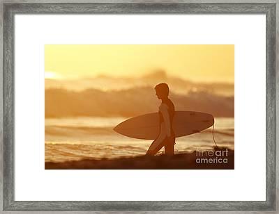 California, San Clemente, Surfer Walking Towards Ocean At Sunset. Editorial Use Only. Framed Print by MakenaStockMedia