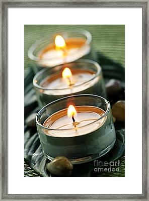 Candles On Green Framed Print by Elena Elisseeva