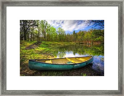 Canoeing At The Lake Framed Print by Debra and Dave Vanderlaan