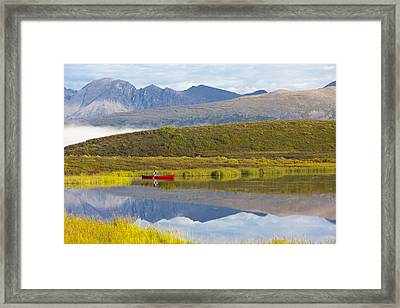 Canoeist On A Tundra Pond Along The Framed Print by Michael DeYoung
